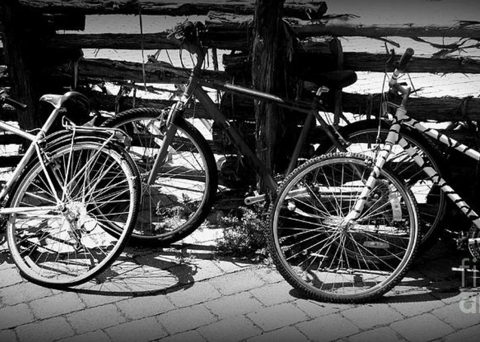 Bike Greeting Card featuring the photograph Black And White Leaning Bikes by Emily Kelley