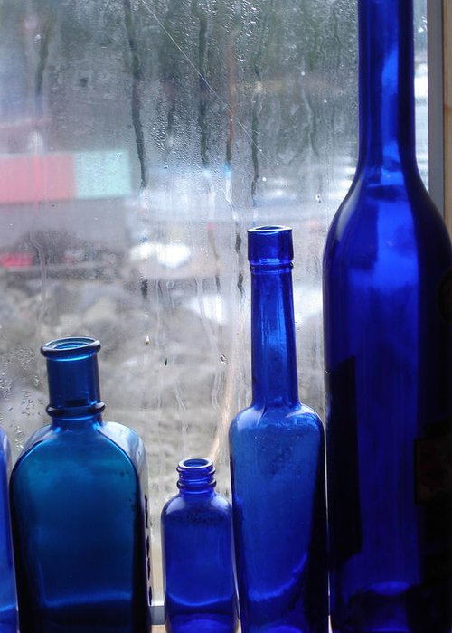 Aurora Explorer Greeting Card featuring the photograph Blue Bottles by Bobbi Mercouri