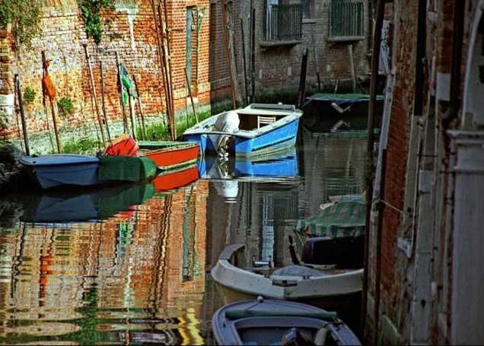 Venice Greeting Card featuring the photograph Boats On Canal In Venice by Michael Henderson