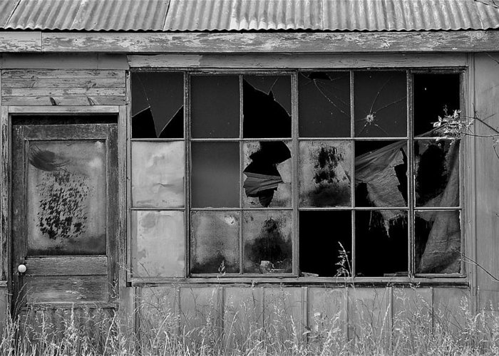 Broken Store Black White Greeting Card featuring the photograph Broken Store Front Black White by Kevin Mitts