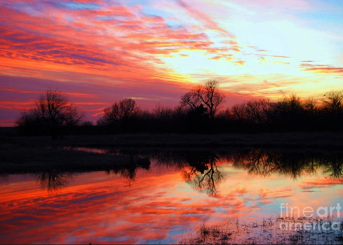 Clouds Greeting Card featuring the photograph Calming Sunset by Larry Keahey