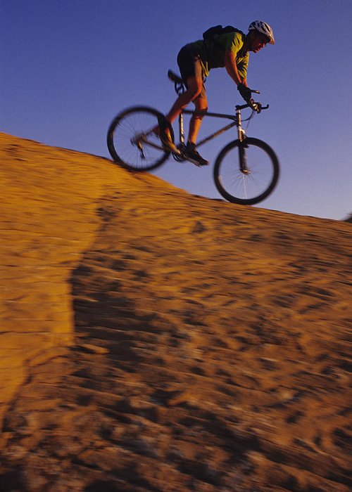 Adventure Sports Greeting Card featuring the photograph Caucasian Male Mountain Biking by Bobby Model