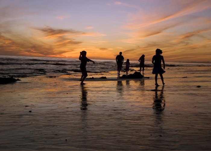 Usa Greeting Card featuring the photograph Children Playing On The Beach At Sunset by James Forte