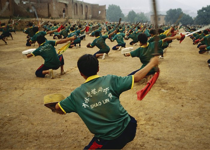 Asia Greeting Card featuring the photograph Children Practice Kung Fu In A Field by Justin Guariglia