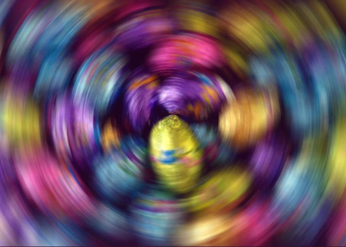 Easter Greeting Card featuring the photograph Chocolate Easter Eggs With Spin Effect by Steve Ohlsen