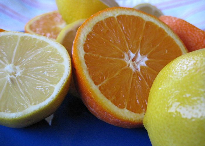 Citrus Greeting Card featuring the photograph Citrus On Blue Plate by Kim Pascu