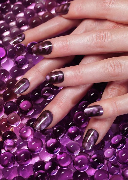 Manicure Greeting Card featuring the photograph Closeup Of Woman Hands With Purple Nail Polish by Maxim Images Prints