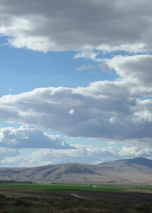 Clouds Greeting Card featuring the photograph Cloudbreaks Over Rattlesnake by Ruth Stromswold