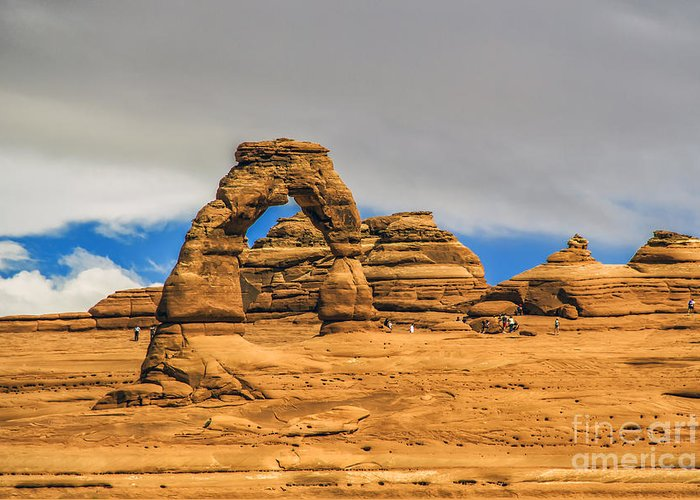 Arches Greeting Card featuring the photograph Clouds Over Delicate Arch by Roberta Bragan