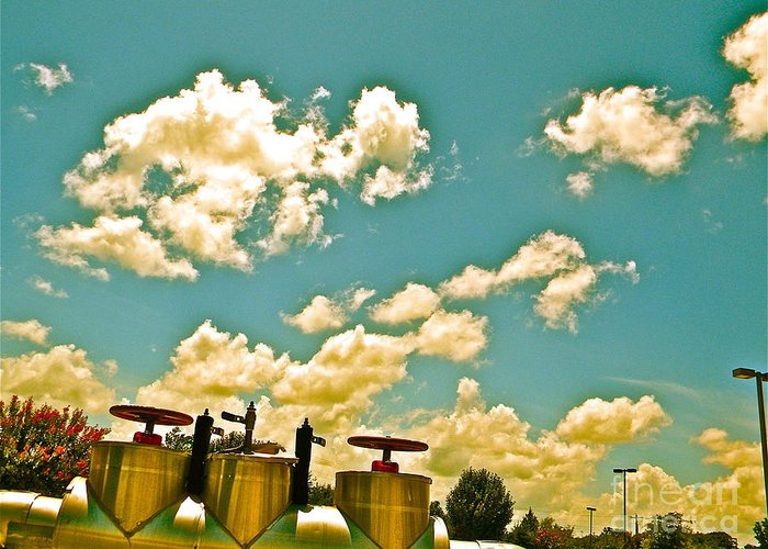 Clouds Greeting Card featuring the photograph Clouds Over Oil Field Equipent by Chuck Taylor