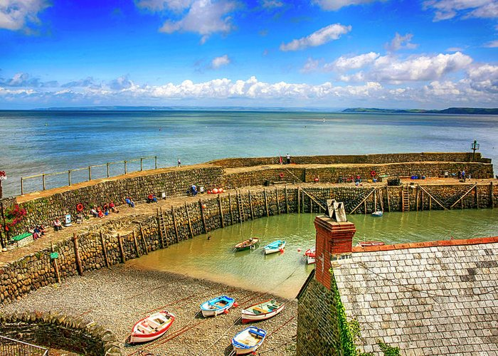 Hillside Greeting Card featuring the photograph Clovelly Harbor In Devon, Uk by Chris Smith