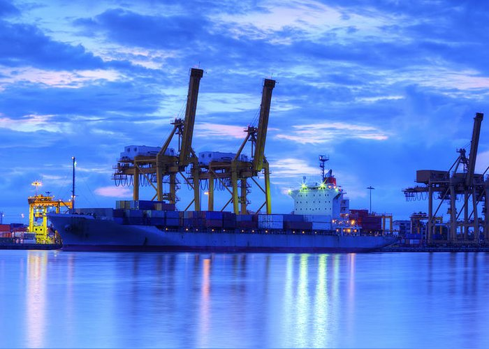 Bangkok Greeting Card featuring the photograph Container Cargo Freight Ship With Working Crane Bridge In Shipya by Anek Suwannaphoom