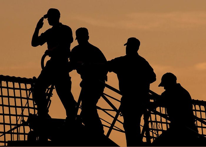 Color Image Greeting Card featuring the photograph Crewmen Salute The American Flag by Stocktrek Images