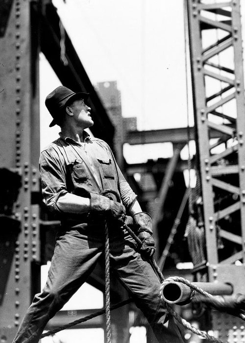 Black And White Photograph; B/w Photo; Photography; Architecture; Exterior; Facade; Male; Construction; Building; Work; Worker; Workers; Labour; Labourer; Labourers; Builder; Builders; 1930s; 30s; Thirties; Strength; Achievement; Skyscraper; High-rise; Teamwork; Girder; Girders; Scale; Strong; Strength; Challenge; Derrick; Man; Portrait; Empire State Building; Achievement; Challenge; Landmark; Us; Usa; History; Historical; America; American; United States; Overalls; Gloves; Rope; Ropes Greeting Card featuring the painting Derrick Man  Empire State Building by LW Hine
