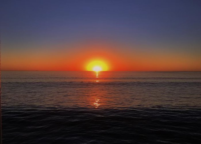 Ocean Greeting Card featuring the photograph Edge Of Night by Michael Krugman