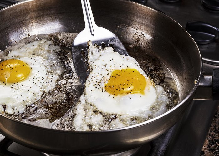 Background Greeting Card featuring the photograph Eggs Cooked With Bacon Grease In Pan by Thomas Baker