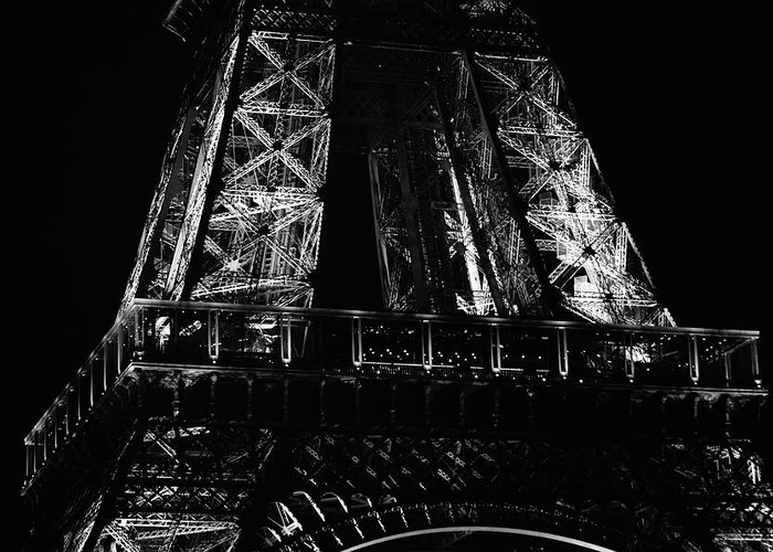 Travelpixpro Greeting Card featuring the photograph Eiffel Tower Illuminated At Night First Floor Deck Paris France Black And White by Shawn O'Brien
