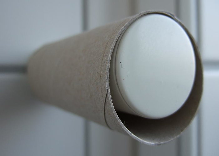 Toilet Paper Greeting Card featuring the photograph Empty Toilet Paper Roll by Matthias Hauser