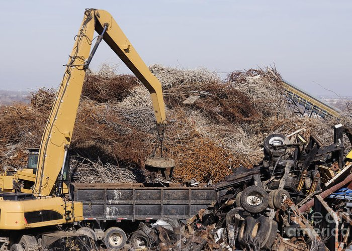 Blue Collar Greeting Card featuring the photograph Excavator Moving Scrap Metal With Electro Magnet by Jeremy Woodhouse