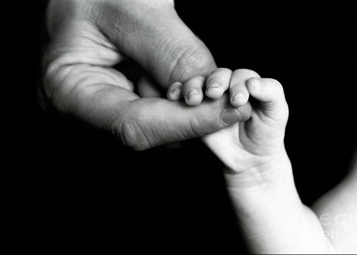 Care Greeting Card featuring the photograph Father Holding Hand Of Baby by Sami Sarkis