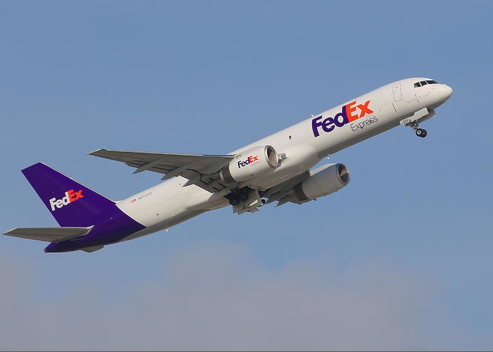 Airplane Greeting Card featuring the photograph Fedex Jet by Dart and Suze Humeston