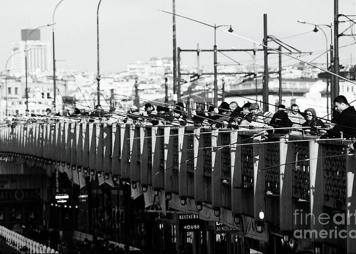 Fishing On The Galata Bridge Greeting Card featuring the photograph Fishing On The Galata Bridge by John Rizzuto