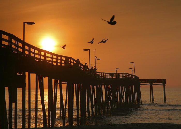 Dawn Greeting Card featuring the photograph Fishing Pier At Sunrise by Steven Ainsworth