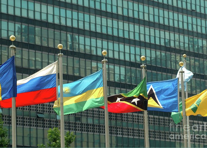 United States Of America Greeting Card featuring the photograph Flags Of Various Nations Outside The United Nations Building. by Richard Wareham
