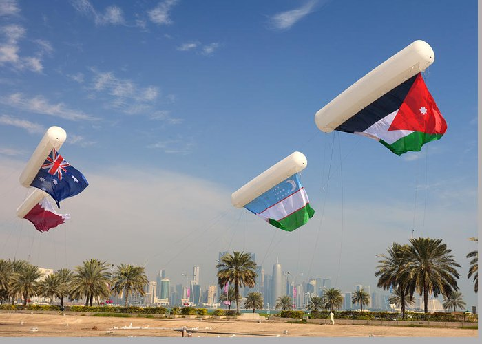 Doha Greeting Card featuring the photograph Flags Over Doha by Paul Cowan