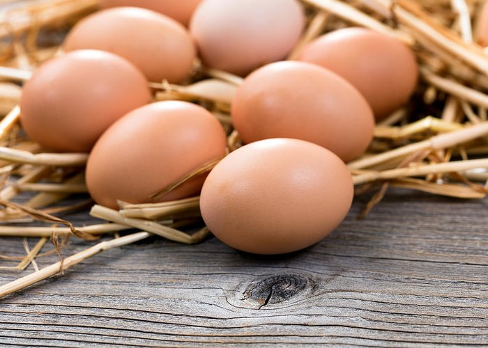 Egg Greeting Card featuring the photograph Fresh Organic Eggs On Rustic Wooden Boards And Straw by Thomas Baker