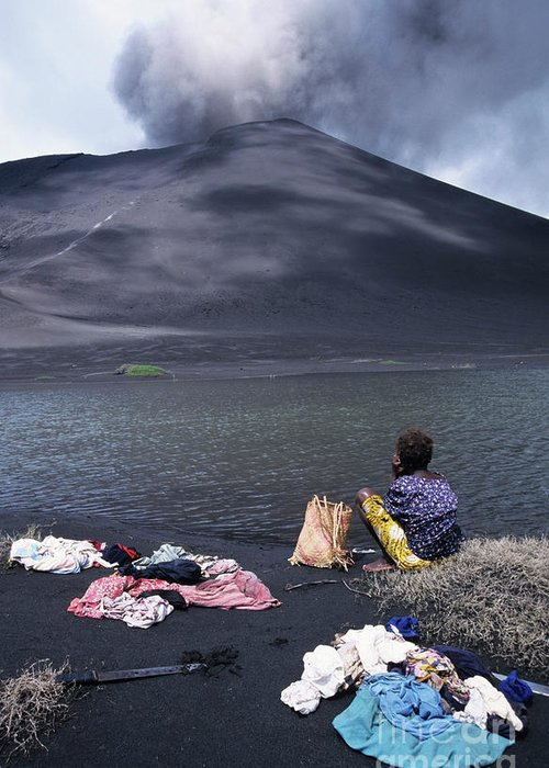 Active Volcano Greeting Card featuring the photograph Girl Washing Clothes In A Lake With The Mount Yasur Volcano Emitting Smoke In The Background by Sami Sarkis