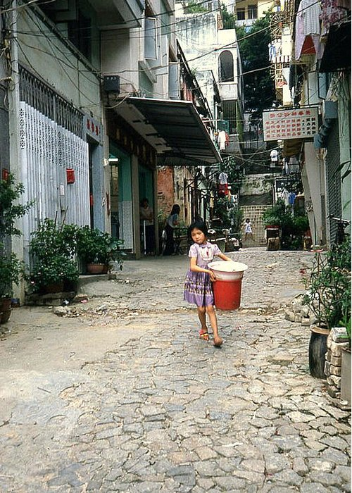 Youth Greeting Card featuring the photograph Girl With Laundry Basket by Maro Kentros
