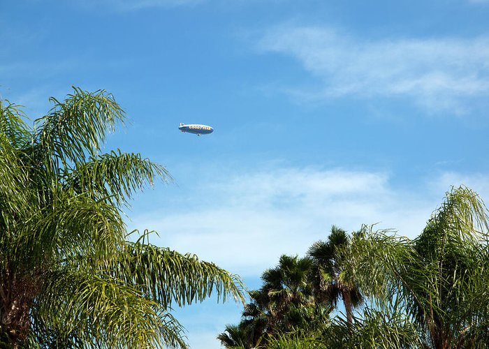 Goodyear Greeting Card featuring the photograph Goodyear Blimp Spirit Of Innovation In Florida by Allan Hughes