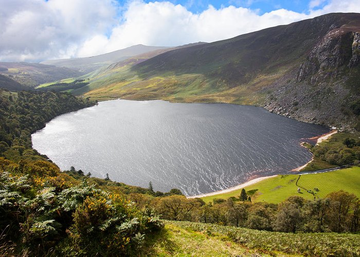 Clouds Greeting Card featuring the photograph Guinness Lake In Wicklow Mountains Ireland by Semmick Photo