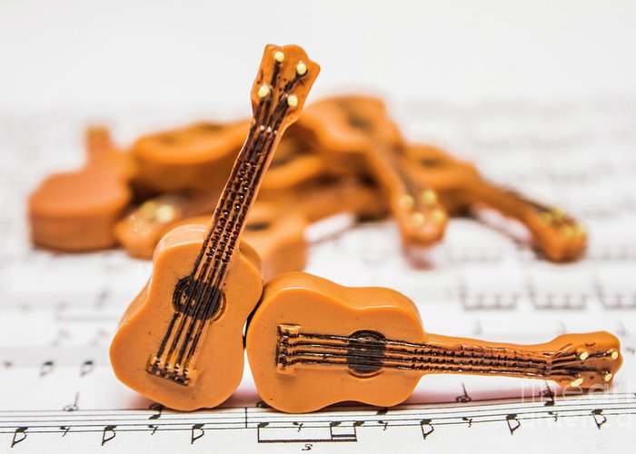 Performance Greeting Card featuring the photograph Guitars On Musical Notes Sheet by Jorgo Photography - Wall Art Gallery