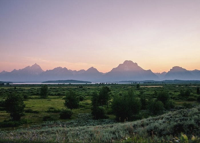Grand Tetons Greeting Card featuring the photograph Hazy Sunset In The Tetons by Margaret Pitcher