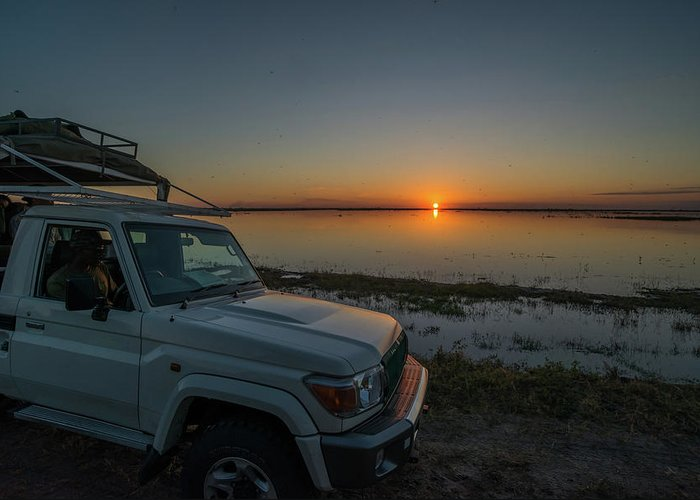 4x4 Greeting Card featuring the photograph Jeep Driver Watching Sunset Over Peaceful River by Ndp