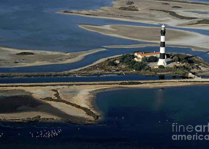 Assistance Greeting Card featuring the photograph La Gacholle Lighthouse Surrounded With Blue Sea In Camargue by Sami Sarkis