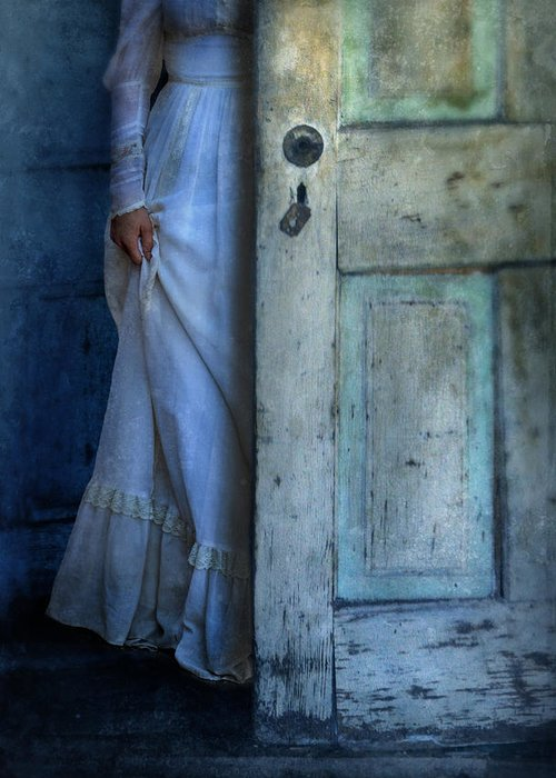 Woman Greeting Card featuring the photograph Lady In Vintage Clothing Hiding Behind Old Door by Jill Battaglia