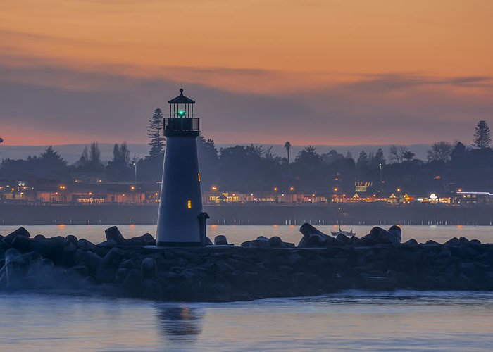 Sunset Greeting Card featuring the photograph Lighthouse And Wharf At Dusk by Bruce Frye