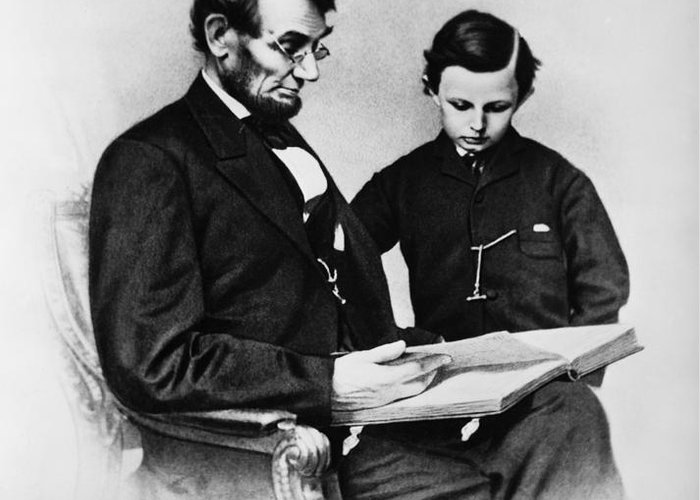 History Greeting Card featuring the photograph Lincoln Reading To His Son by Photo Researchers