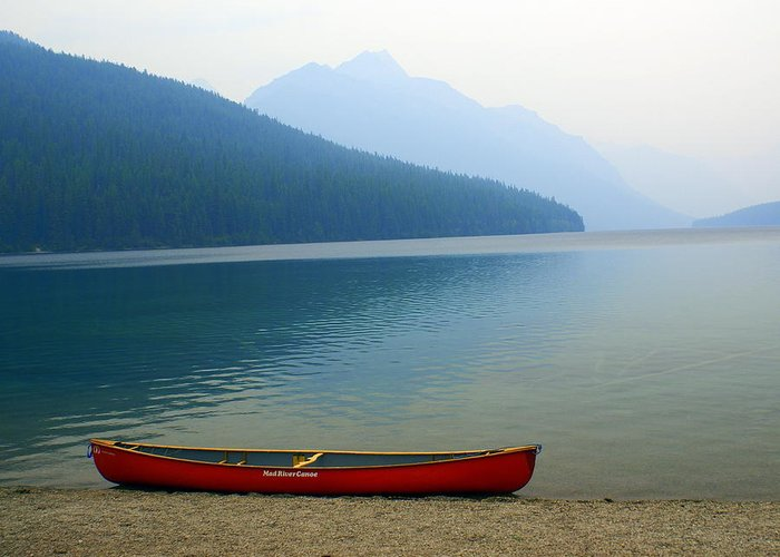 Glacier National Park Greeting Card featuring the photograph Lonly Canoe by Marty Koch