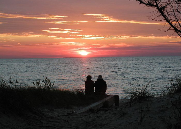 Sunset Greeting Card featuring the photograph Love At Sunset by Ron and Linda Balogh