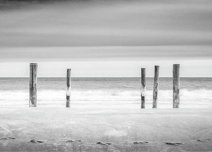 Main Beach Greeting Card featuring the photograph Main Beach Pilings Bw by Ryan Moore