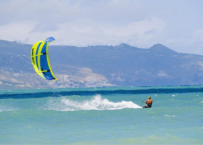 Pacific Islands Greeting Card featuring the photograph Man Kiteboarding In Turquoise Water by Mark Cosslett