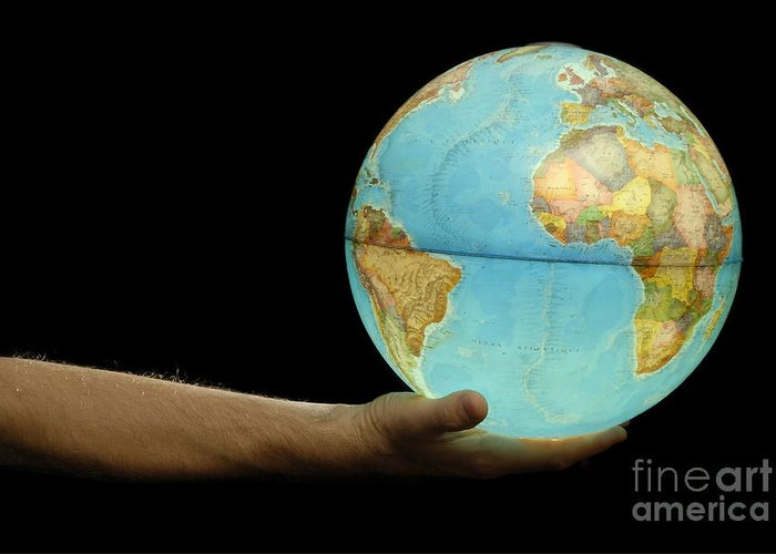 People Greeting Card featuring the photograph Man Offering Illuminated Earth Globe by Sami Sarkis