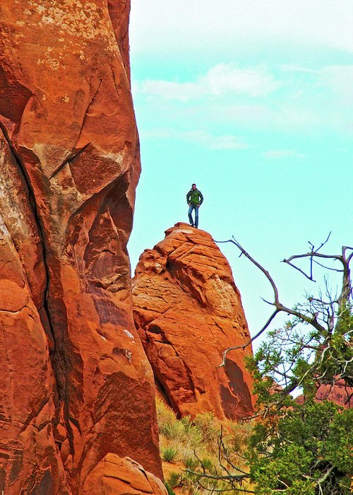 Man On A Rock By Pine Tree Arch Along Devils Garden Trail In Arches National Park Greeting Card featuring the photograph Man On A Rock By Pine Tree Arch Along Devil's Garden Trail In Arches National Park, Utah by Ruth Hager