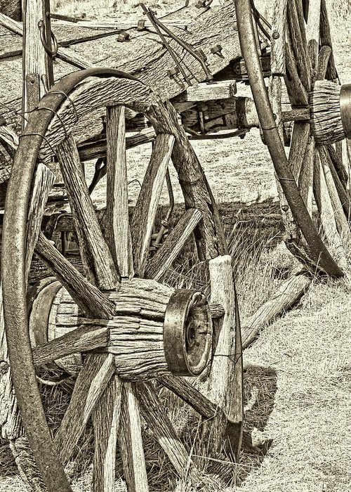 Wheel Greeting Card featuring the photograph Montana Old Wagon Wheels In Sepia by Jennie Marie Schell