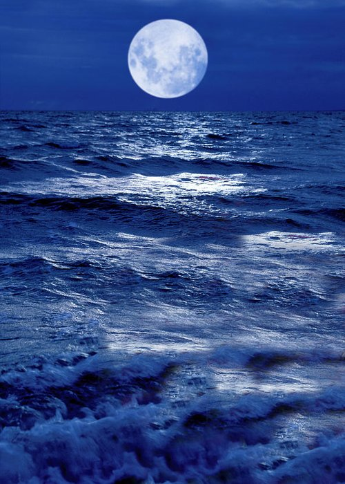 Moon Greeting Card featuring the photograph Moonlight Over The Ocean by Christian Lagereek