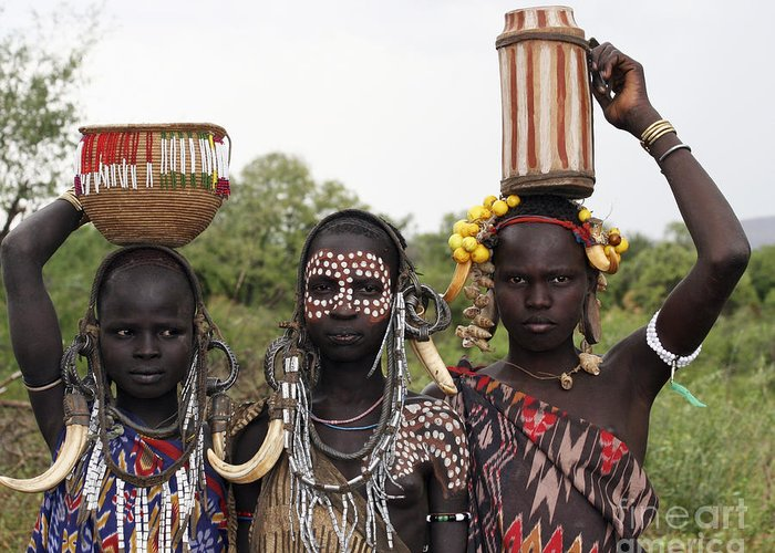 Ethiopia Greeting Card featuring the photograph Mursi Tribesmen In Ethiopia by Gilad Flesch